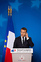 French President Emmanuel Macron gives a press conference during the European Council in Brussels