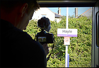 BNPS.co.uk (01202 558833)<br /> Pic: AllTheStations/BNPS<br /> <br /> Hayle train station.<br /> <br /> A pair of railway enthusiasts are on an epic train journey to become the first people to visit every station in Britain. <br /> <br /> Eccentrics Geoff Marshall, 44, and Vicki Pipe, 34, are three weeks into the adventure, which will see them visit 2,563 stations in just three months. <br /> <br /> The couple of seven years from London began in Penzance and have already visited 750 stations, covering the entire South, South West and much of London. <br /> <br /> After visiting an average of 30 stations per day their trip will conclude in August in Thurso, the British mainland's most northernmost town.