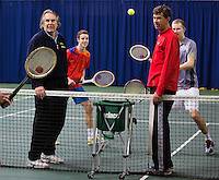 21-02-2014, Netherlands, Eemnes, coach  Michiel Schapers(NED), and Martin Simek(L) looking at their pupils  playing <br /> Photo: Henk Koster