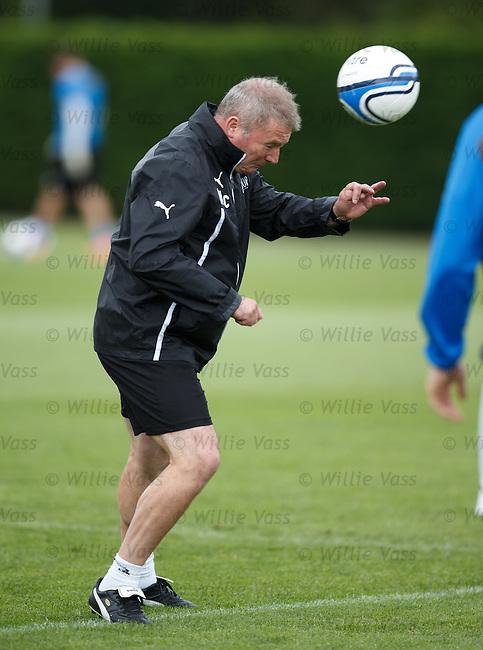 Ally McCoist heads the ball