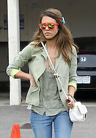 Feeling like neon today? Jessica Alba chose a colorful outfit today and wore red rimmed wayfarers, a cropped blazer jacket with green asymmetrical stripes, neon nail polish and neon colored wedges topped with a plain white Gerard Darel bag. Los Angeles, California on 12.6.2012..Credit: Correa/face to face.. /MediaPunch Inc. ***FOR USA ONLY*** NORTEPHOTO.COM<br />