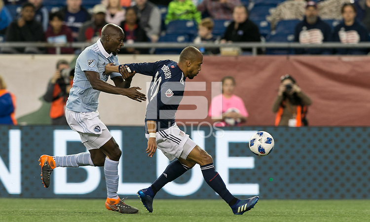 Foxborough, Massachusetts - April 28, 2018: First half action. In a Major League Soccer (MLS) match, New England Revolution (blue/white) vs Sporting Kansas City (light blue/white), at Gillette Stadium.