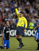 22 May 2008: Ryan Cochrane of the Earthquakes gets a yellow card from referee Jair Marrufo after a hard foul during the first half of the game at Buck Shaw Stadium in San Jose, California.   San Jose Earthquakes and Houston Dynamo are tied 0-0 at halftime.
