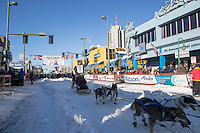 Wade Marrs and team leave the ceremonial start line with an Iditarider and handler at 4th Avenue and D street in downtown Anchorage, Alaska on Saturday March 4th during the 2017 Iditarod race. Photo © 2017 by Brendan Smith/SchultzPhoto.com.