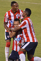 BARRANQUIILLA -COLOMBIA-23-02-2014. Juan Guillermo Dominguez (C) de Atlético Junior celebra un gol contra Deportivo Cali durante partido por la fecha 7 de la Liga Postobón I 2014 jugado en el estadio Metropolitano Roberto Meléndez de la ciudad de Barranquilla./ Atletico Junior  player Juan Guillermo Dominguez (C) celebrates a goal against Deportivo Cali during match for the 7th date of the Postobon League I 2014 played at Metropolitano Roberto Melendez stadium in Barranquilla city.  Photo: VizzorImage/Alfonso Cervantes/STR