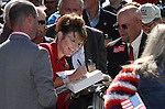 Sarah Palin autographs items for the crowd at the Tea Party Express kick off Monday morning, Oct. 18, 2010, in Reno, Nev. .Photo by Cathleen Allison