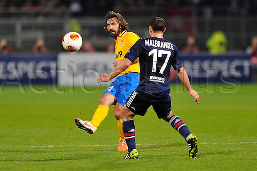 03.04.2014. Lyon, France. Europa league football, last 16. Lyon versus Juventus. Steed Malbranque (lyon) challenges Andrea Pirlo (juventus)
