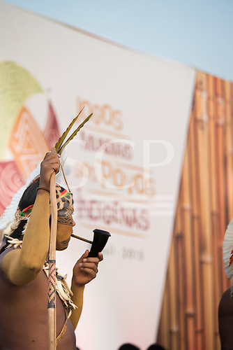 A Pataxo archery participant takes a break to smoke his pipe during the International Indigenous Games, in the city of Palmas, Tocantins State, Brazil. Photo © Sue Cunningham, pictures@scphotographic.com 24th October 2015