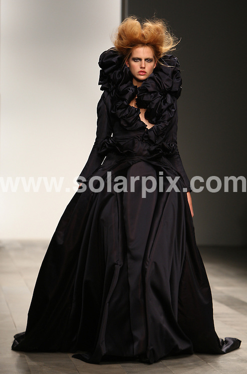 **ALL ROUND PICTURES FROM SOLARPIX.COM**                                             **WORLDWIDE SYNDICATION RIGHTS**                                                                                  Caption: The Caroline Charles catwalk show at London Fashion Week 2011, London, UK. 18 February 2011                                                                              This pic: Models                                                                                             JOB REF:12824        MLW       DATE:18.02.2011                                                            **MUST CREDIT SOLARPIX.COM OR DOUBLE FEE WILL BE CHARGED**                                                                      **MUST AGREE FEE BEFORE ONLINE USAGE**                               **CALL US ON: +34 952 811 768 or LOW RATE FROM UK 0844 617 7637**