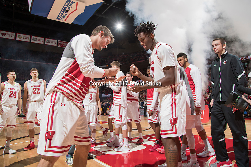 Wisconsin Badgers teammates Aaron Moesch, left, with teammate Nigel Hayes (10) during an NCAA Big Ten Conference men's college basketball game against the Michigan Wolverines Tuesday, January 17, 2017, in Madison, Wis. The Badgers won 68-64. (Photo by David Stluka)