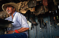 "Floriano, a life-long employee of the Fazenda Rio Negro ranch in Brazil's Pantanal Mato Grossense wetaland, met his wife and rasied a son -- current ranch foreman Fernando -- at the ranch. Now retired, Floriano takes a seat in the tack barn to brag about his shooting skills with other cowboys. ""I can hit a mosquito with my .22,"" he says. The wetland, half the size of France, supports one of the most intact arrays of wildlife in the world, despite 200 years of cattle ranching. Subdivision of properties in the region weaken the economic viability of the traditional ranches."