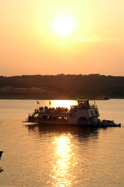 People enjoy an evening on a paddleboat on Lake Travis, Texas.
