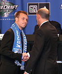 12 January 2007: Michael Harrington (l) shakes hands with Major League Soccer commissioner Don Garber (r) after being selected by the Kansas City Wizards with the #3 overall pick. The 2007 MLS SuperDraft was held in the Indianapolis Convention Center in Indianapolis, Indiana during the National Soccer Coaches Association of America's annual convention.