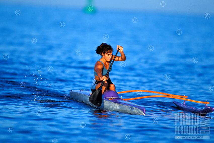 Tiare getting a workout paddling her outrtigger canoe off the Kona coast on the Big Island of Hawaii