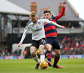 17th March 2018, Craven Cottage, London, England; EFL Championship football, Fulham versus Queens Park Rangers; Ryan Manning of Queens Park Rangers puts pressure on Tim Ream of Fulham