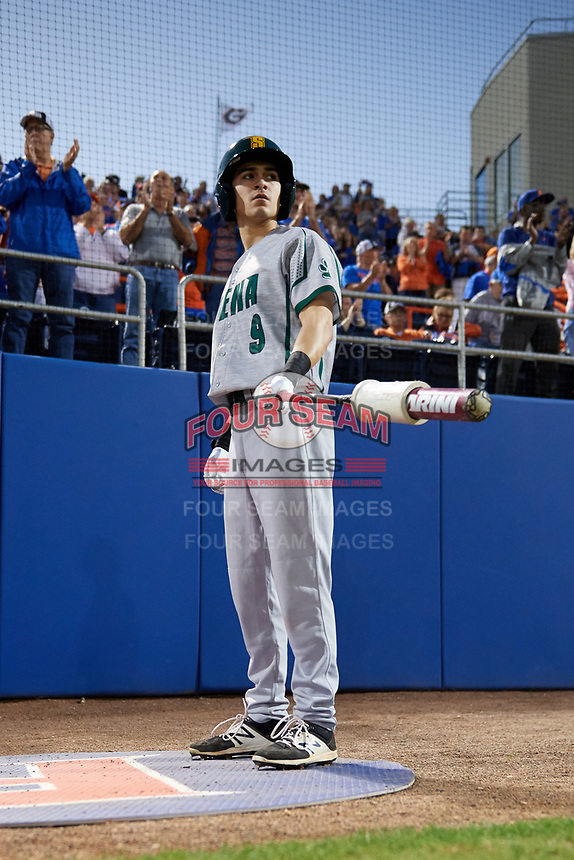 Siena Saints shortstop Marcos Campos (9) warms up before a game against the Florida Gators on February 16, 2018 at Alfred A. McKethan Stadium in Gainesville, Florida.  Florida defeated Siena 7-1.  (Mike Janes/Four Seam Images)