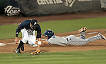 Reno Aces third baseman Tyler Bortnick takes the throw as Round Rock Express' Luis Hernandez reaches safely after hitting a triple in a minor league baseball game Thursday Aug. 16, 2012, in Reno, Nev. The Express won 9-8 in extra innings..Photo by Cathleen Allison
