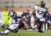Texas A&M defensive back Floyd Raven Sr. (5) bring down Missouri tackle Russell Hansbrough (32) during first half of an NCAA football game, Saturday, November 15, 2014 in College Station, Tex. Texas A&M leads 13-6 at the halftime. (Mo Khursheed/TFV Media via AP Images)