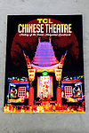 LOS ANGELES - JULY 24: TCL Chinese Theatre Commemorative Book at the handing over of the first-ever complete, commemorative & official full-color Souvenir Program for the 90 year-old TCL Chinese Theatre, beautifully relating both the Theatre's glorious history in full color and comprehensive text and historic anecdotes and that of Hollywood outside the TCL Chinese Theatre IMAX on July 24, 2017 in Los Angeles, California