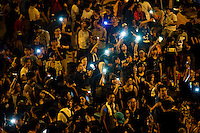 HONG KONG, HONG KONG SAR, CHINA - OCTOBER 01: Demonstrators hold high lit cellphones to form a 'sea of lights' in Admirality, as part of a pro-democracy sit-in known as 'Occupy Central', blocking traffic on Gloucester Road, an otherwise busy multi-lane thoroughfare in Hong Kong, on October 1, 2014. Now sometimes called the 'Umbrella revolution', the Occupy Central civil disobedience movement began in response to China's decision to allow only Beijing-vetted candidates to stand in the city's 2017 election for the top civil position of chief executive. (Photo by Lucas Schifres/Getty Images)