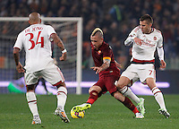 Calcio, Serie A: Roma vs Milan. Roma, stadio Olimpico, 20 dicembre 2014.<br /> Roma's Radja Nainggolan, center, is challenged by AC Milan's Jeremy Menez, right, during the Italian Serie A football match between AS Roma and AC Milan at Rome's Olympic stadium, 20 December 2014. At right, AC Milan's Nigel De Jong.<br /> UPDATE IMAGES PRESS/Riccardo De Luca