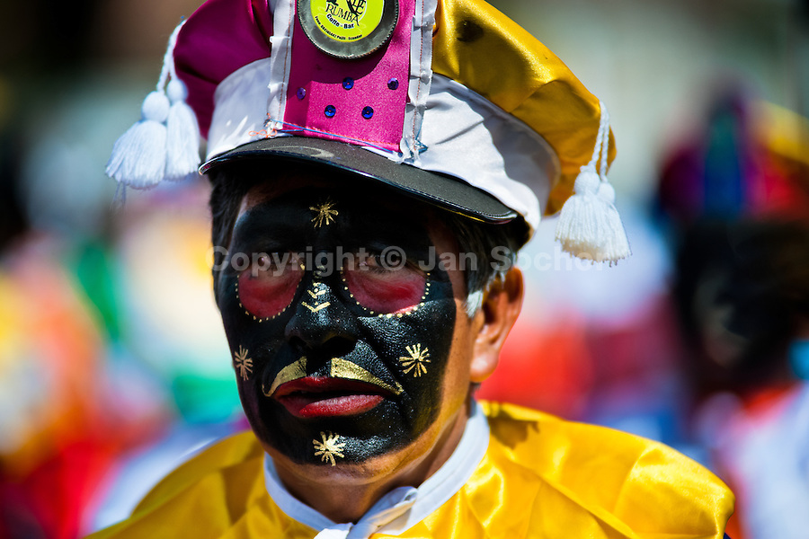 A dancer (danzante) takes part in the religious parade within the Corpus Christi festival in Pujilí, Ecuador, 1 June 2013. Every year in June, thousands of people gather in a small town of Pujili, high in the Andes, to celebrate the Catholic feast of Corpus Christi. Introduced originally during the Spanish conquest of South America, this celebration merges Catholic rituals of Holy Communion with the traditional Andean harvest and sun festivities (Inti, the Inca sun god). Women dancers perform wearing brightly colored costumes while men dancers wear chest ornaments and heavy elaborate headdresses adorned with mirrors, jewelry, or natural items (shells). Being a dancer in the Corpus Christi ceremonial parade (El Danzante) is considered an honour and a privilege by the indigenous people in Ecuador.