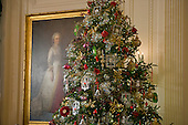 A Christmas tree stands in the East Room near the iconic portrait of first lady Martha Washington during the press preview of the 2012 White House Christmas decorations in Washington, DC on Wednesday, November 28, 2012..Credit: Ron Sachs / CNP