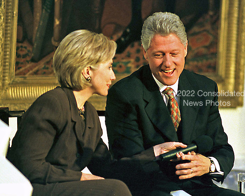"""United States President Bill Clinton and first lady Hillary Rodham Clinton share a light moment during the live broadcast of the """"Millennium Evening Lecture Series from the East Room of The White House in Washington, DC on 18 September, 1998.<br /> Credit: Ron Sachs / CNP"""