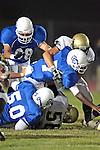 Culver City, CA 09/17/10 - Walt Proenca (Peninsula #56), Kevin Porche (Culver City #7), Sean Cogman (Culver City #50) and David Pinagua (Culver City #68) in action during the Peninsula Panthers-Culver City Centaurs varsity football game at Culver City High School.
