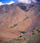 Berber village and farm terraces in deep mountain valley, Atlas Mountains, near Imlil, Morocco