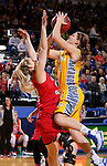 BROOKINGS, SD - FEBRUARY 21:  Macy Miller #12 from South Dakota State takes the ball to the basket against Heidi Hoff #42 from the University of South Dakota in the first half of their game Saturday evening at Frost Arena in Brookings. (Photo by Dave Eggen/Inertia)