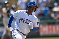 Round Rock shortstop Jurickson Profar (10) runs to first base against the Nashville Sounds in the Pacific Coast League baseball game on May 5, 2013 at the Dell Diamond in Round Rock, Texas. Round Rock defeated Nashville 5-1. (Andrew Woolley/Four Seam Images).