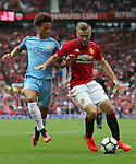 Leroy Sane of Manchester City tussles with \mu2during the Premier League match at Old Trafford Stadium, Manchester. Picture date: September 10th, 2016. Pic Simon Bellis/Sportimage