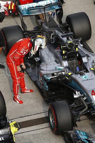 8th April 2017, Shanghai Circuit, Shanghai, China; Chinese Grand Prix Qualifying;  <br /> #5 Sebastian Vettel (GER, Scuderia Ferrari)<br /> looking at #44 Lewis Hamilton (GBR, Mercedes AMG Petronas) car