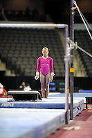 02/20/09 - Photo by John Cheng for USA Gymnastics.  US gymnast Kamerin Moore performs on uneven bars in a meet against Japan before the Tyson American Cup at Sears Centre Arena in Chicago.