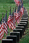 Flags on grave markers at Gettysburg National Cemetery, Gettysburg, PA, USA