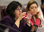 Assemblywoman Irene Bustamante-Adams, D-Las Vegas, works in a committee hearing at the Legislative Building in Carson City, Nev., on Tuesday, Feb. 3, 2015. <br /> Photo by Cathleen Allison