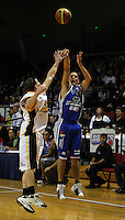 Troy McLean shoots a three-pointer during the NBL Basketball match between Wellington Saints and Devon Dynamos Taranaki at TSB Bank Arena, Wellington, New Zealand on Friday, 11 April 2008. Photo: Dave Lintott / lintottphoto.co.nz