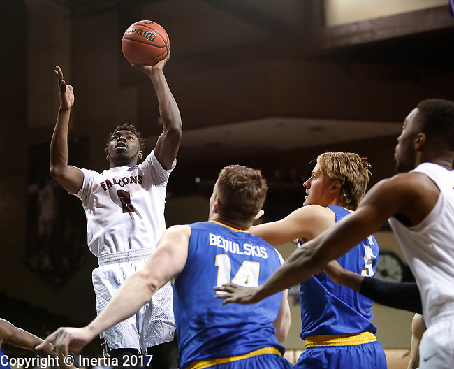 SIOUX FALLS, SD: MARCH 22: Matt Bingaya #2 of Fairmont shoots over Rollins defenders during the Men's Division II Basketball Championship Tournament on March 22, 2017 at the Sanford Pentagon in Sioux Falls, SD. (Photo by Dick Carlson/Inertia)