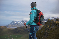 Female hiker with over Yttersand beach, Moskenesøy, Lofoten Islands, Norway