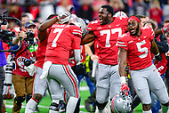 Indianapolis, IN - DEC 1, 2018: Ohio State Buckeyes quarterback Dwayne Haskins (7) is mobbed by teammates after defeating the Northwestern Wildcats 45-24 in the Big Ten Championship game at Lucas Oil Stadium in Indianapolis, IN. (Photo by Phillip Peters/Media Images International)