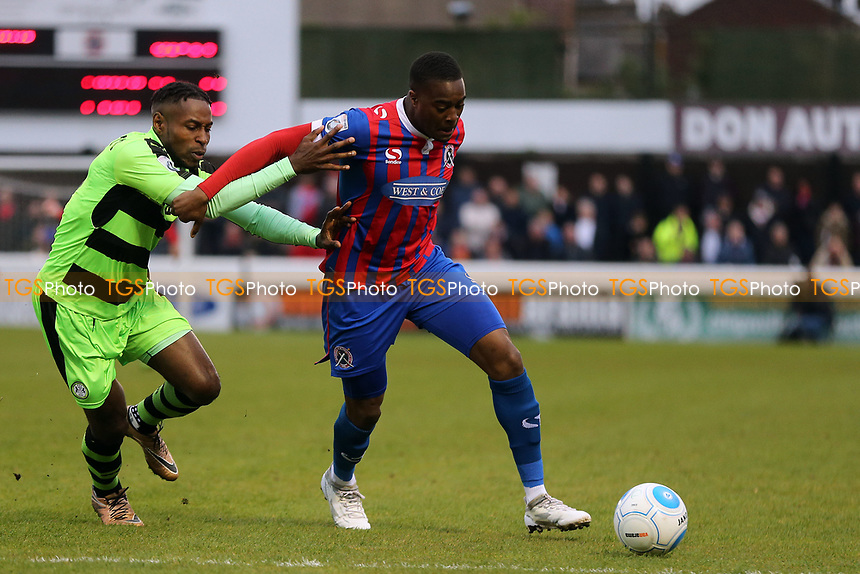 Fejiri Okenabirhie of Dagenham and Redbridge and Dale Bennett of Forest Green Rovers during Dagenham & Redbridge vs Forest Green Rovers, Vanarama National League Play-Off Semi-Final Football at the Chigwell Construction Stadium on 4th May 2017