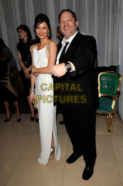 GEORGINA CHAPMAN & HARVEY WEINSTEIN.The Harvey Weinstein post Bafta party, St. Martin's Lane, London, England..February 10th, 2008.British Academy of FIlm & Televison Arts Awards full length white dress gold sleeveless trim clutch bag purse black suit couple hand.CAP/FIN.©Steve Finn/Capital Pictures