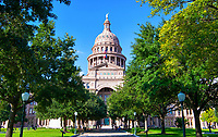 Texas Capitol in Austin - Texas Capitol in downtown Austin on a nice sunny day with blue skies.  The trees over the walkway were all looking nice and green and happy since all the rain we have been having in the last month.  The state capitol building is in a historical building in downtown Austin and this was the south facing side that looks down congress ave.  All the legislation action takes place here for the state of Texas. The building inself was done in an renaissance rivival architecture with red granite and Oak Hill limestone with a rather large dome on top.