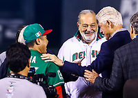 Carlos Bremer, Carlos Slim, Bill Clinton, former president of the United States, and Saul El Canelo Alvarez, Mexican boxer at the launch of the first ball during the opening ceremony of the Caribbean Series 2018 held at EstadioCharros de Jalisco in Guadalajara, Mexico, Friday 2 Feb 2018. (AP Photo / Luis Gutierrez)