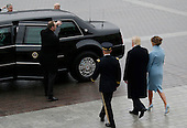 United States President Donald Trump walks with First Lady Melania Trump from the Capitol Building to a car after Trump is sworn in at the 58th Presidential Inauguration on Capitol Hill in Washington, D.C. on January 20, 2017.   <br /> Credit: John Angelillo / Pool via CNP