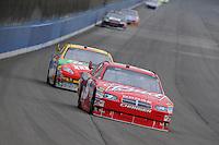 Oct. 11, 2009; Fontana, CA, USA; NASCAR Sprint Cup Series driver Kasey Kahne (9) leads Kyle Busch during the Pepsi 500 at Auto Club Speedway. Mandatory Credit: Mark J. Rebilas-