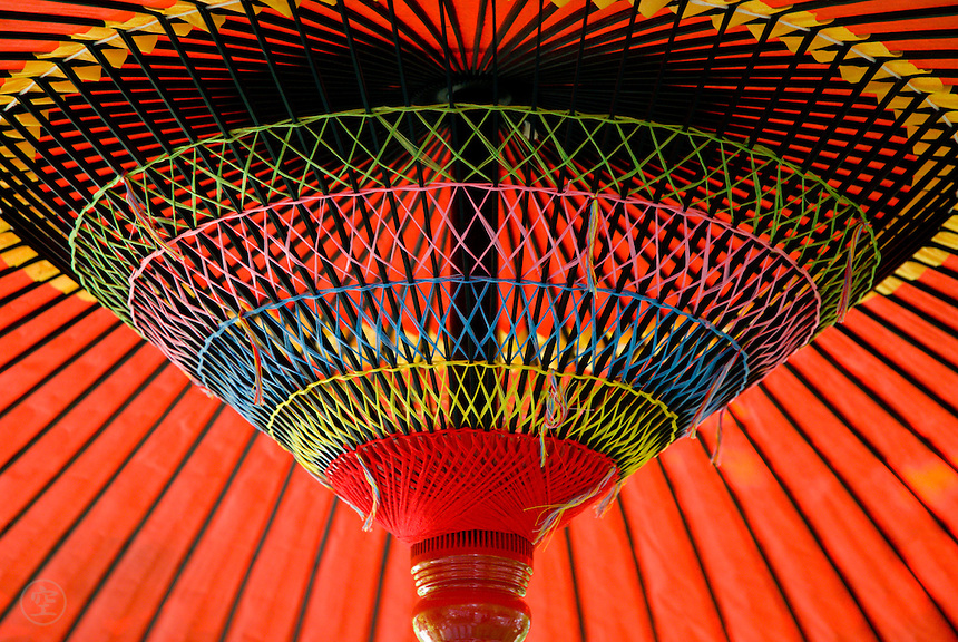 Red parasol, or wagasa, with brightly coloured detailing.