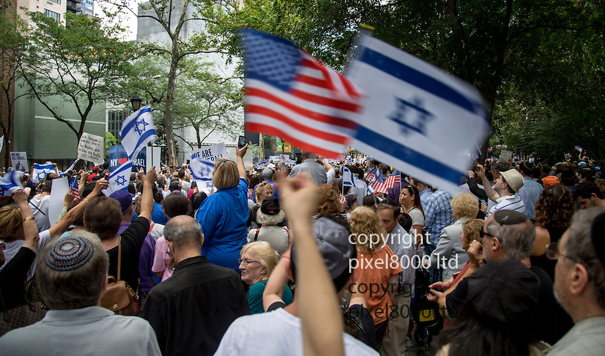 Pic shows: UN<br /> <br /> United Nations building in New York today where a huge pro Israeli rally of 10000 people was taking place.<br /> <br /> slogans included Kick Hamas Ass and Israel Has A Right To Defend Itself.<br /> <br /> <br /> <br /> Pic by Gavin Rodgers/Pixel 8000 Ltd