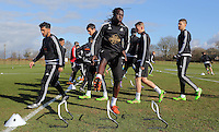 Pictured: Bafetimbi Gomis (C) with other players Thursday 25 February<br />